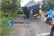 Jalan Berlubang, Truk Asal Bali Patah As Roda di Sampang