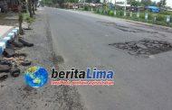 Pasca Banjir, Sejumlah Aspal Jalan di Kota Sampang Ngelupas